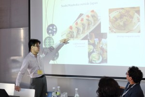 "Voltaire Cang presenting his paper ""Sushi Leaves Home"""